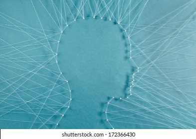 Personal communication. The head of a man connected to exterior by threads