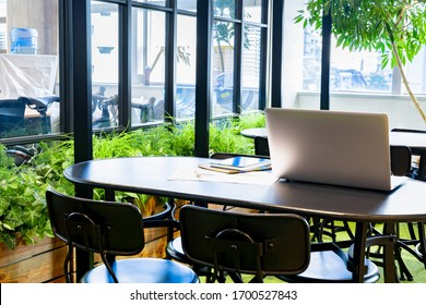Personal computer, notebook, and business work materials in the coworking space (telework image)