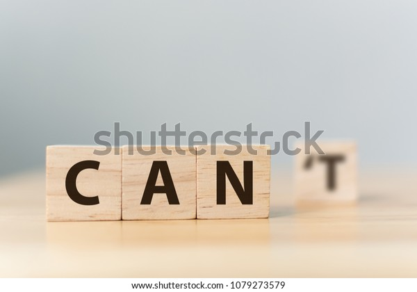 Personal development and career growth or change attitude yourself concept. Wood block cube with word CAN