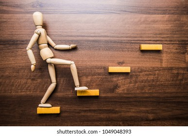 Personal development, personal and career growth, progress and potential concepts. Coach - human resources officer, manager, mentor- motivate employee to growth. wooden human figure
