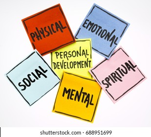 personal development concept - handwriting in black ink on isolated sticky notes