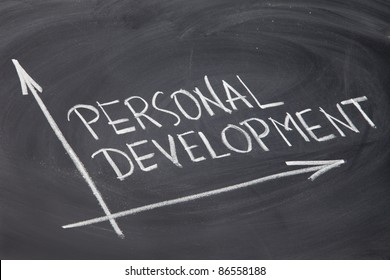 personal development concept - white chalk drawing on a blackboard
