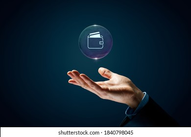 Personal finance and card payment concepts. Hand with soap bubble with symbol of the wallet and credit or debit card inside.