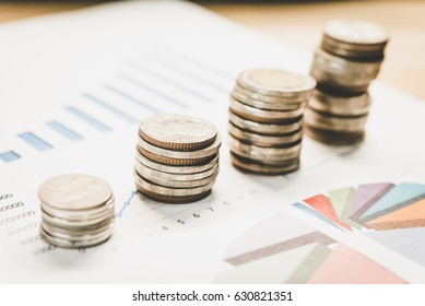 Personal financial planning concept. Businessman workplace with papers for financial planning. Business people discussing the charts and graphs showing the results of successful financial planning.