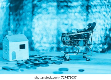 Personal financial planning and online shopping as concept, Shopping cart and a lot of money to represent Money, Cash savings growth for retirement in future.
