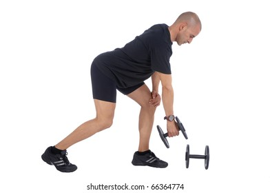 Personal fitness trainer (coach) exercising with dumbells over white background