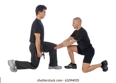 Personal Fitness trainer exercising in gym