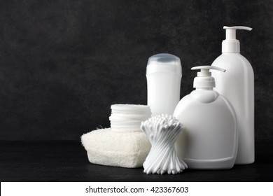 personal hygiene items on a black background