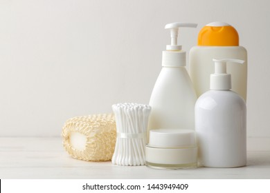 Personal hygiene products. Body care cosmetics. White bottles and vials on a light background. SPA. Relax.