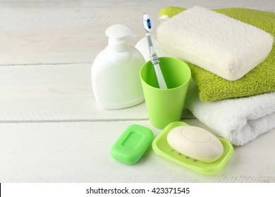 personal hygiene products on white wooden background