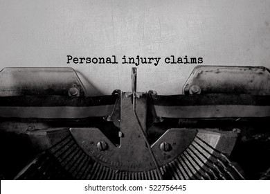 Personal injury claim typed words on a vintage typewriter