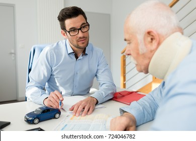 personal injury lawyer in meeting with client wearing neck brace