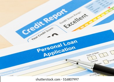 Personal loan application form excellent credit score with pen