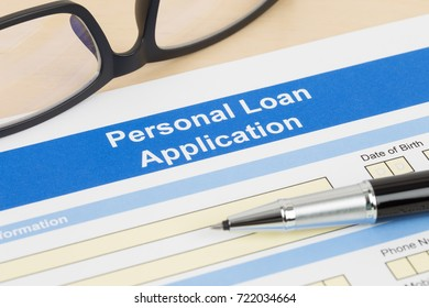 Personal loan application form with glasses, and pen
