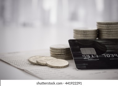 personal loan finance concept. credit card with coins pile on passbook banking.