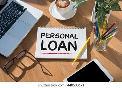 PERSONAL LOAN open book on table and coffee Business