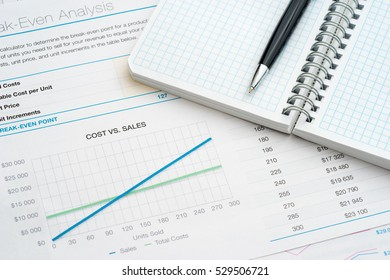 Personal notepad on business charts
