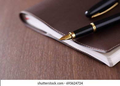 personal organizer and pen on the table