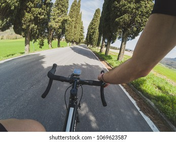 Personal perspective of a cyclist training in Tuscany on a racing bicycle on a spring day