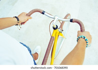 Personal point of view of man hands holding handlebar of a vintage bicycle. First person view of a guy doing active sport with a bike. Concept of leisure lifestyle with healthy activities.