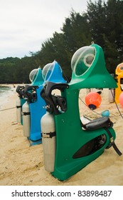 Personal recreational underwater submarine scooters wait on a beach ready for tourist riders to enjoy marine life without learning scuba. Vertical copy space