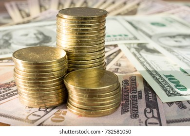 Personal saving, piles of gold coins on dollar bills,  supplementary pension concept closeup selective focus