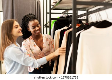 Personal Shopper. Fashion Stylist Helping Her Client Buy New Clothes Shopping In Trendy Clothing Store. Copy Space