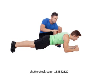 Personal trainer  and boy making push-ups isolated on a white background