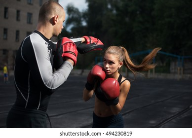personal trainer coach men and women engaged in boxing at the stadium