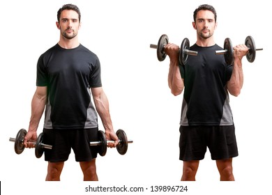 Personal Trainer doing standing dumbbell curls for training his biceps, isolated in white