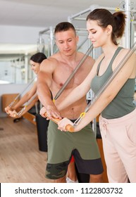 Personal trainer. Fitness instructor.Exercises in the gym.