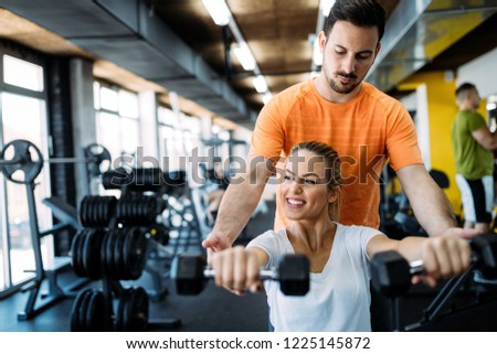 Personal trainer giving instructions gym stock photo edit now