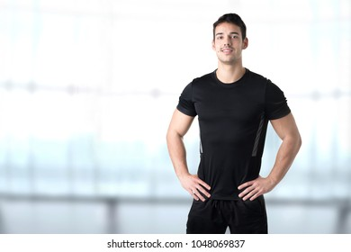 Personal Trainer With Hands on Waist in a Gym