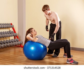 Personal trainer helping a girl learn to press fitbar. Fitness club. Weight loss program. Health and Fitness.