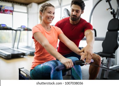 Personal trainer helping woman reach goals