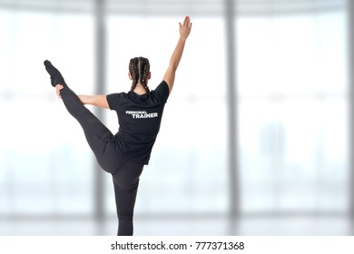Personal Trainer standing with one leg up in a gym