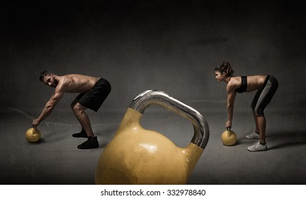 personal trainer and student with kettleball, dark background