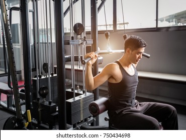 Personal trainer weight-lifting in fitness center