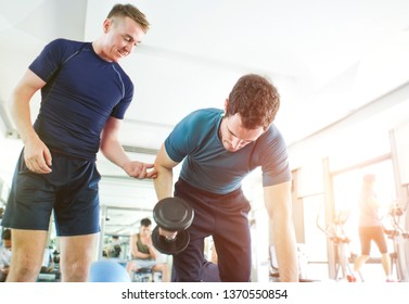 personal training workout with dumbbell coach man body build in gym club