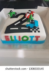 Personalised cars cake, fondant moulded cars, sponge covered cake. Childrens party cake.