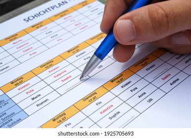 Personnel staff planning to devide personnel in shift schedule by hand and pen