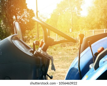 Persons driving a tractor in agriculture.