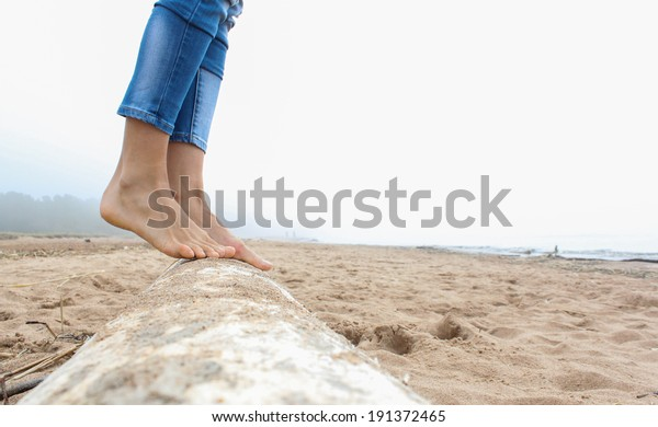 Persons feet on sandy beach