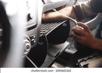 Person's Hand Cleaning Air Conditioner With Bottle In Car