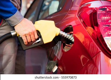 Person's Hand Refueling Car's Tank By Holding Petrol Pump Nozzle