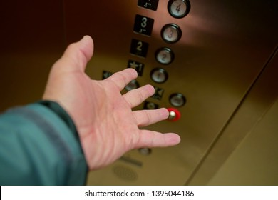 Person`s hand showing frustration and fear while getting stuck on a malfunctioning elevator.