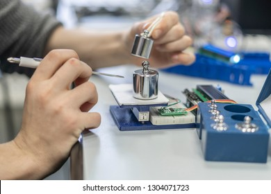 persons hands use electric scale or weighter. microelectronics