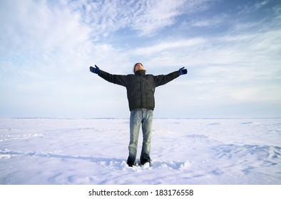 Persons on ice. Man with arms raised