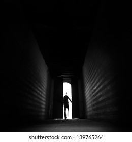 Person's silhouette entering the unknown.