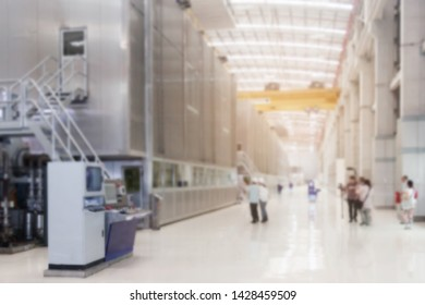 Persons visit site manufacturing factory blurred